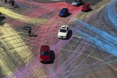 Earlier this year, a group of unknown bikers spilled about 500 liters of water-based environmentally-friendly paint on the asphalt of Berlin's Rosenthaler Platz. Plenty of cars and their wheels, during rush hour, became the tool for this colorful guerilla art piece.