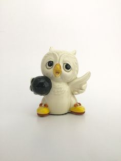 A personal favorite from my Etsy shop https://www.etsy.com/listing/463977869/vintage-ceramic-bowling-owl-figurine
