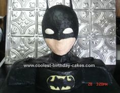 Batman Cake: I made this Batman cake using a Styrofoam wig head. The chest and shoulders are cake. I used two 8 inch circles for the chest and a 9 inch cake for the