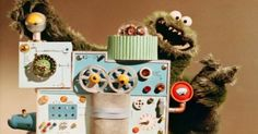 In 1966, Henson was contracted by IBM to put together four short films for the company. These films showcased early incarnations of Kermit and Rowlf. Some of the shorts were intended as icebreakers for business meetings, while others featured the Muppets demonstrating IBM's products in a humorous fashion. One short is also notable for featuring the very first appearance of the Cookie Monster, who eats a coffee machine and winds up exploding.
