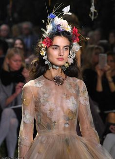 """Maria Grazia Chiuri chose the Musee Rodin as the place to stage her first Dior Haute Couture collection,creating a full blown garden maze of green flora with the """"tree of life"""" as the …"""