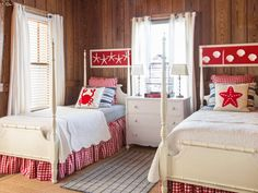 Painted white (Parchment White by Glidden), the twin beds found on Craigslist and the estate sale dresser don't compete with the bedroom's richly grained paneling. The rest of the room is done in country-meets-beach hues of red, white, and blue.