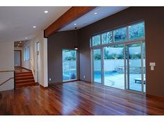 The house is wrapped with rich wood floors, beams, and trim.