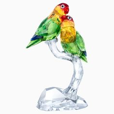 A stunning design, Lovebirds will add vibrant color and romance to your home. The pair are captured in a moment of loving affection during their mating ritual. Sparkling in nine different colors, they feature 1'133 glittering facets. With the focus exclusively placed on cut crystal in this piece, the new rock base adds additional brilliance. A true representation of Swarovski's craftsmanship, it is a must-have for any collector or lover of nature. Decoration object. Not a toy. Not suitable for c Swarovski Gifts, Swarovski Crystal Figurines, Swarovski Crystals, Best Affordable Watches, Different Colors, Vibrant Colors, Collectible Figurines, Glass Figurines, Glass Animals