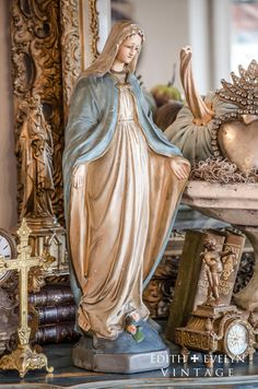 Gorgeous vintage Miraculous Mary statue dating from the 1940s. Made of solid chalkware, she is a lovely large size measuring 21 tall x 9.5 wide
