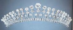 Close up of a belle epoque diamond tiara, circa 1900. 23 upright diamond pinnacles, each topped with a larger, circular diamond.