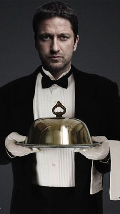"{Gerard Butler} ""Good day, I am Pavel, and I am the head of staff here at the Carter residence. I am 40 years old and my son, Moriarty, is a butler like I am. I've worked in this house for many years and I'm here to serve its residents. Call me if you need anything."""