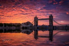 London. Shot of Tower Bridge at dawn. Sky was even more colourful than the photo - it really was amazing. The reflection is artificial using Flaming Pear's Flood filter.