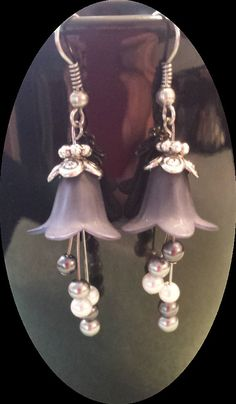 Black lucite flower earrings with hanging pearls  Check out Bashfulbaubles on Etsy only $6.00
