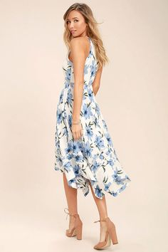 The Zahara Blue and White Floral Print Midi Dress is as stunning as a field of flowers! Woven cotton has a dreamy blue and white floral print that covers the sleeveless bodice with bateau neckline. Pierced embroidery trims the arm openings, fitted waist, and handkerchief hem of the midi skirt. Hidden back zipper/clasp.