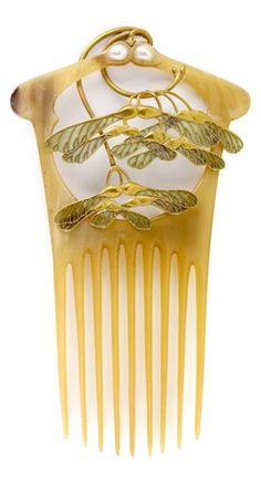 An Art Nouveau comb, by René Lalique, France, circa 1900. Composed of gold, patinated blond horn, enamel and pearls. H. 16 cm. #Lalique #ArtNouveau #comb