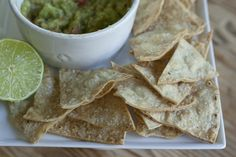Homemade Tortilla Chips:  • Cut corn or flower tortillas into mini triangles  • Coat a baking sheet with vegetable oil  • Arrange tortilla slices and spray with vegetable oil and sprinkle with coarse salt  • Bake at 400º until golden (about 5 - 10 minutes)  • Sprinkle with salt and lime