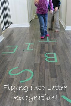 Such a fun way to practice letter recognition with preschoolers! Paper airplanes and painters tape - simple and fun alphabet recognition activities. Could do this with lots of things, like sight words, numbers. Letter Activities, Kids Learning Activities, Fun Learning, Teaching Kids, Phonics Activities, Toddler Learning, Learning Spanish, Early Learning, Teaching Resources