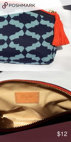 """J. Crew EUC small bag / makeup case J. Crew Factory cloth makeup case, toiletry bag, or small clutch.  Navy and light blue cotton with orange zipper top and orange tassel. Inside is in pristine condition. Waterproof liner. 9"""" x 6.5""""    