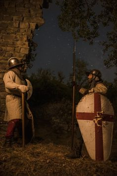 Medieval Infantry Men during a starry night guard next to ruins.