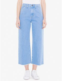 A 70's-inspired wide legsilhouette constructed from12 oz. denim for a sturdy, yet midweight,non-stretch wear.TheYoko Jeanfeatures a medium stone wash,high-rise waist, tonal belt loops, classic gold chain stitching,dual front slantpockets, dual back squarepockets with back darts, wide leg design with frayed hem, andzipper with button closure. This jean wears true to size in a relaxed silhouette.Enzyme-treated and softener-rinsed for a lived-in feel.