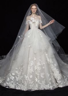 This glamorous wedding gown from S.eri Wedding Dress featuring floral lace applique is a beautiful work of art! » Praise Wedding Community