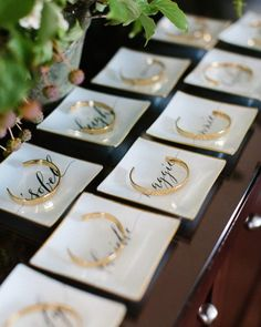 Danielle gifted her bridesmaids custom jewelry trays featuring Anne Robin's calligraphy and gold bracelets from the Tusk Monogram Collection. Each bracelet was engraved with the coordinates where she had met them, with their birthstone serving as the degree symbols. The inside of each piece was engraved with their initials and Danielle and Brian's wedding date.