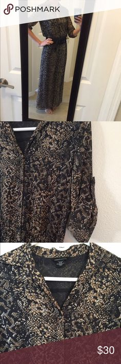 Moda International Button Down Snake Print Maxi Button-down with sash belt. Semi-sheer fabric. It is lined with a sheer black fabric. Beautiful snakeskin pattern. Button tabs on sleeves. Dresses Maxi