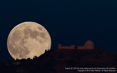 """Fabio Pettinati sent SPACE.com a photo he took of the August 2013 """"blue moon"""" rising next to Lick Observatory, Mt. Hamilton, Calif. """"Due to the nature of the terrain, there are a handful of spots along the road where one can see the observatory. Of these spots, only this one allowed me this view. I literally had a space of 30 feet to shoot from,"""" Pettinati wrote SPACE.com in an email."""