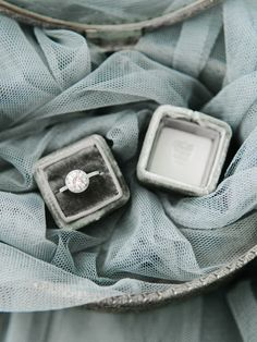 Engagement ring in a gray velvet ring box by The Mrs. Box. Image by Rachel May Photography.