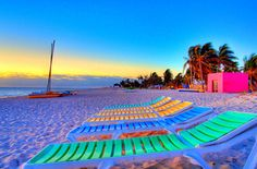 Beautiful tropical beach with neon lounges :]