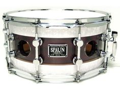 """these unique snare drums feature a """"shell within a shell"""" design also.  The outer shell holds all the parts (lugs, strainer, butt, etc) and has outside holes for venting.  The inner shell has no parts attached, so it resonates independently from the outer shell.  The inner shell only has """"breather"""" holes in line with the outside shell vents. #spaun #drums"""