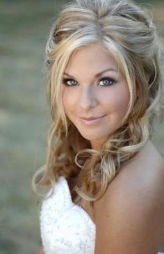 Possible hair style for wedding. It's up but still relaxed, and she has some pieces surrounding her face.