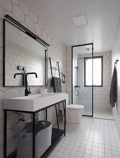 industrial bathroom Make your bathroom look bigger, improve the decor and maximize its space with these 15 narrow bathroom ideas! Take a look at these great tips and tricks that will make your bathroom stylish and functional. Industrial Bathroom Design, Long Narrow Bathroom, Narrow Bathroom, Bathroom Makeover, Stylish Bathroom, Bathroom Layout, Bathroom Interior, Bathroom Renovations, Luxury Bathroom