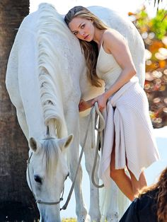 Star Tracks: Monday, February 16, 2015 | HORSIN' AROUND | Amanda Seyfried strikes a pose during a photo shoot in Miami Beach, Florida, on Friday.