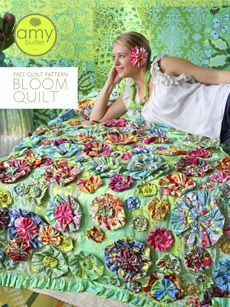 Bloom quilt ... downloaded the pfd ... I have a purchased pink and white stripe cover, pretty but plain, I could cover it with big and small yo-yos of scrap fabric...