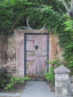 Garden Gate with Lone Post    A wooden garden gate on a side street in St. Augustine.
