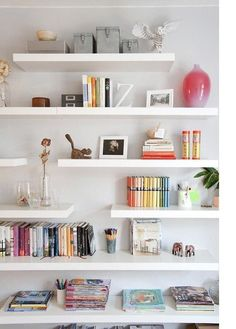 floating shelves. LOVE the placement and different lengths.