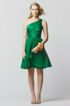 Style 670 from Wtoo by Watters is a cocktail length bridesmaid dress with a natural waist and one-shoulder neckline.  #wedding #bridesmaids #emerald #green #watters