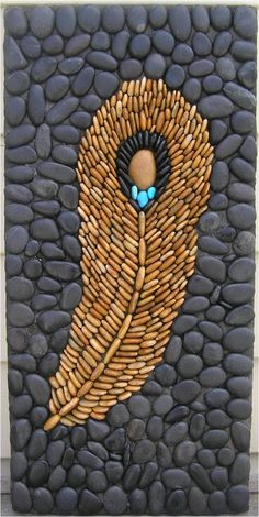 Pebble mosaic feather...Another inspirational idea for a pebble mosaic. This would look great in my garden path!!