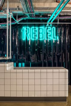 Studio wants to make going to the gym feel like a night out, so fitted out this London basement with neon lighting, black walls and a pop-up bar Club Design, Gym Design, Retail Design, Pharmacy Design, Visual Merchandising, Warehouse Gym, Luxury Gym, Gym Interior, Interior Design