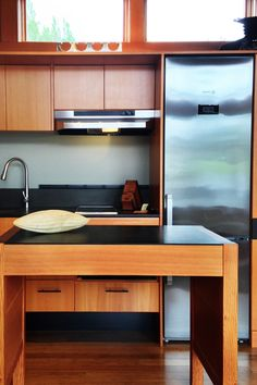The 450 Square Foot House Features Custom Fir Cabinets, Paperstone Recycled  Countertops,