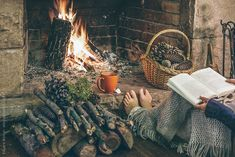 Reading a Book by the Fireplace | Cozy home. Woman reading a book in front fireplace. by BONNINSTUDIO ...