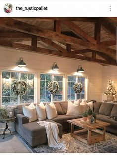 How gorgeous are these rustic beams in this great room? Loving the wreaths on the windows highlighted by those amazing light fixtures! @the_rusticpallet #homedecorlivingroomcozy #RoomWallDecor Winter Living Room, Cozy Living Rooms, Living Room Grey, Living Room Decor, Living Room Arrangements, Living Room Furniture Arrangement, Living Room Light Fixtures, Living Room Lighting, Kitchen Lighting