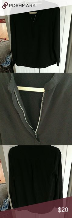 Black kenar top Black collarless top from kenar. Has a zip up on front can make the opening as large or as small as you'd like. In excellent condition Kenar Tops Blouses