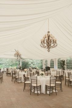 Love the tent lining and hanging chandeliers!