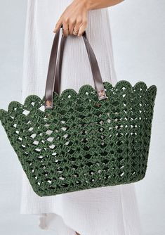 Coated, crochet lace tote bag with scallop finish and vegan leather handles. Per… Coated, crochet lace tote bag with scallop finish and vegan leather handles. Perfect picnic or beach tote bag! Crochet Handbags, Crochet Purses, Crochet Tote Bags, Tote Handbags, Purses And Handbags, Bag Women, Rainbow Crochet, Purse Patterns, Style Patterns