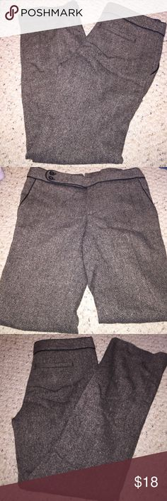 Banana Republic Tweed Pant Tweed pant with black trim. Pant length and inside lining are shorten.  Pant in perfect condition. Worn once only.  31' inches inseam. She'll/body: 42% polyester, 34% wool, 19% Rayon and 1% spandex, 4% other fibers.   Inside lining is 100% polyesters. Banana Republic Pants Trousers