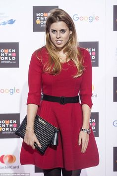 Resplendent in a £450 red fitted dress by Milly, the 26-year-old style icon showcased her feminine figure