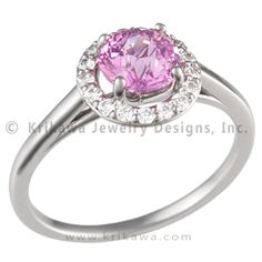 Cathedral Halo Pave Engagement Ring with Pink Sapphire - Want a ring that is all about the center stone? Look no further. The dainty band in this design is topped with a halo of diamond pave.   - This halo engagement ring is shown with a pink sapphire.