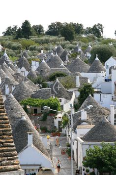 """Trulli houses in Puglia region of Southern Italy. Alberobello is the """"trulli capital"""". Stone homes with a cone top, many over 200 years old. Wonderful Places, Great Places, Beautiful Places, Places To Visit, Beautiful Scenery, Italy Vacation, Italy Travel, Monuments, Alberobello Italy"""