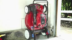 Save space in your garage or shed by switching to this SmartStow lawn mower that has a folding handle and a special engine to allow the mower to be stored vertically against a wall without any leaks!