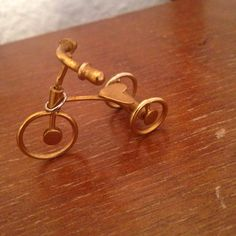 19.99 Vintage Gold Bicycle Pendant by kalonkate on Etsy.  Necklace pendant found at vintage german market. Vintage jewelry for the win