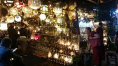 Jemaa el fnaa, Marrakech, Morocco.  Admiring all the lanterns. And cats
