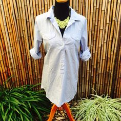 J. Crew Popover Tunic Item was purchased for beach holiday but never worn and has been sitting in dresser. 100% cotton; long sleeves; chest pockets, hits at mid thigh; machine wash. J. Crew Swim Coverups